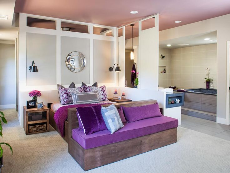 As seen on HGTV's hit show Elbow Room, Chip and his team redesigned the Howells' master suite to include lots of closet space, an open concept floor plan, and brilliant, bold colors. The Howells were looking for a spa retreat, and Chip has delivered with an oversized whirlpool tub, a multitude of candles, and deep purple hues that are sure to bring anyone into tranquility.