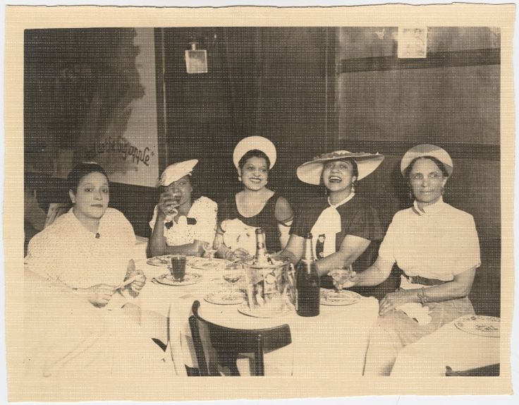 """Ada """"Bricktop"""" Smith (far left) seated with ladies at table. 1920"""