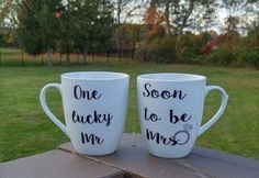 White coffee mugs (2) for newly engaged couples. Mugs can be personalized with a last name at no additional cost to read... One lucky Mr. Soon to be