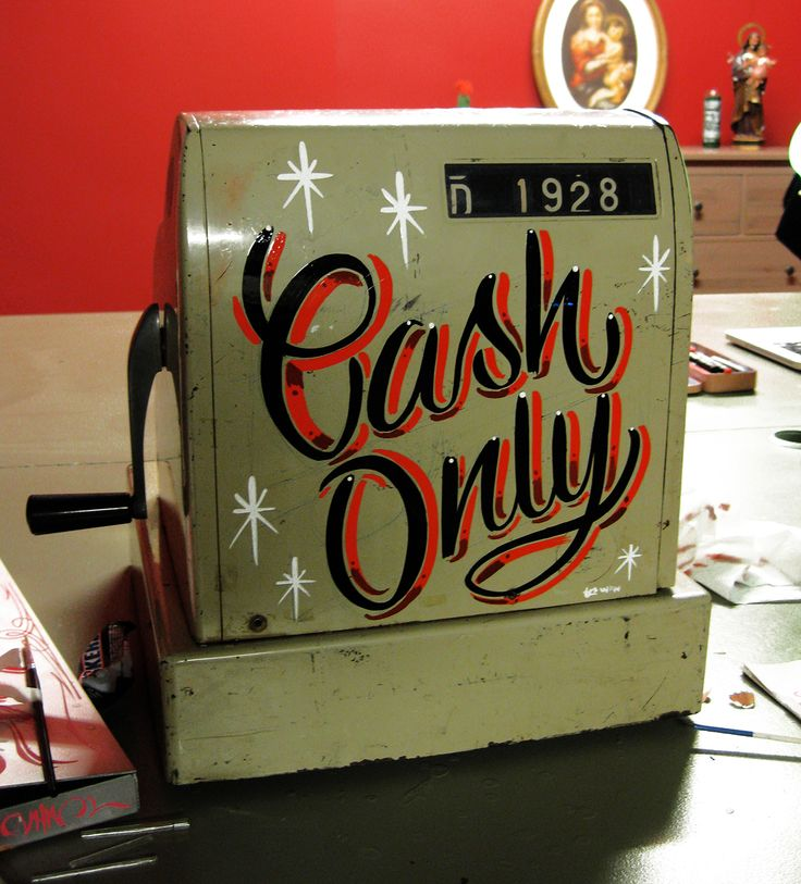 Lettering on an old cash register.