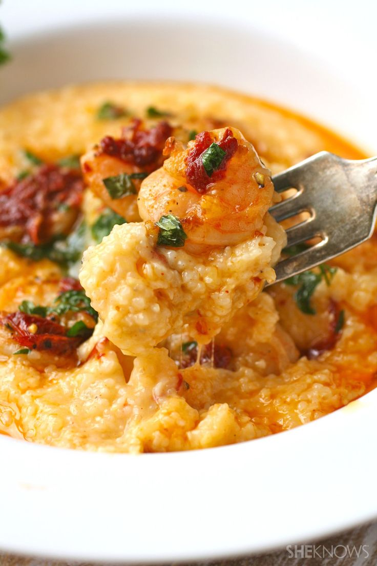Southern Shrimp and Grits 1 pound frozen shrimp, thawed, tails removed 1 cup uncooked grits 1 cup shredded Monterey Jack cheese 1 cup shredded cheddar cheese 1/2 teaspoon paprika 1 tablespoon butter 1 tablespoon olive oil 1/2 teaspoon salt 1/4 teaspoon ground black pepper 2 garlic cloves, minced 2 chipotle peppers in adobo sauce, minced, plus 1 teaspoon adobo sauce (more to taste) 2 tablespoons lemon juice 2 tablespoons fresh parsley, chopped