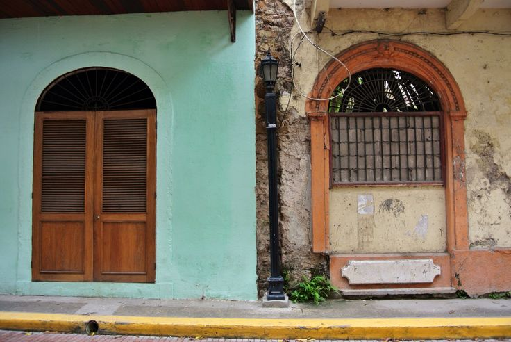 Contrast of a finished building next to an abandoned one in Casco Viejo, Panama