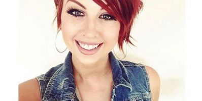 amazing-red-hair-with-a-simple-black-top-and-denim-vest