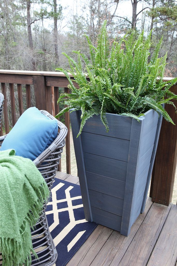 """I gotta admit that when we saw how awesome these tall planters turned out that I got weirdly possessive and didn't want to share the plans. I think it has to do with the fact that other people online are always claiming """"HEY THAT's MINE!"""" and trying to copyright weird things and getting up in..."""
