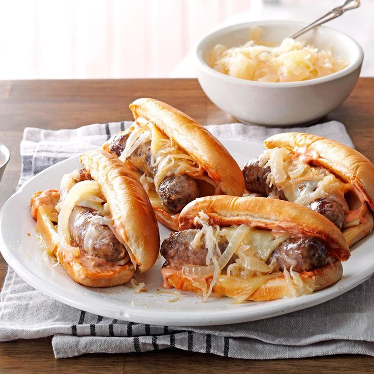 Slow-Cooked Reuben Brats Recipe -Sauerkraut gives these beer-simmered brats a big flavor boost, but it's the special chili sauce and melted cheese that put them over the top. Top your favorite burger with some of the chili sauce; you won't be sorry.—Alana Simmons, Johnstown, Pennsylvania