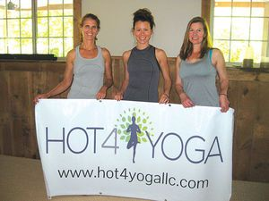 Hot 4 Yoga owners, from left, are: Cheri Thomilson, Val Weaver and Caroline Douglas.