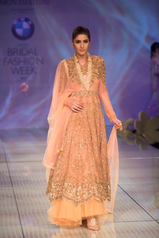 Tarun Tahiliani pink peach gold anarkali lehnga with tulle border. More here: http://www.indianweddingsite.com/bmw-india-bridal-fashion-week-ibfw-2014-tarun-tahiliani-show/