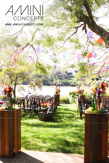 A wedding in a garden and by the river at the same time. It's a perfect setting for a ceremony with garlands all over the place. More pics: http://www.aminiconcepts.com/wedding-event-styling/vintage-blooms/  #gardenwedding #styling #events #weddings #eventstyling #decoration #australia #brisbane #queensland