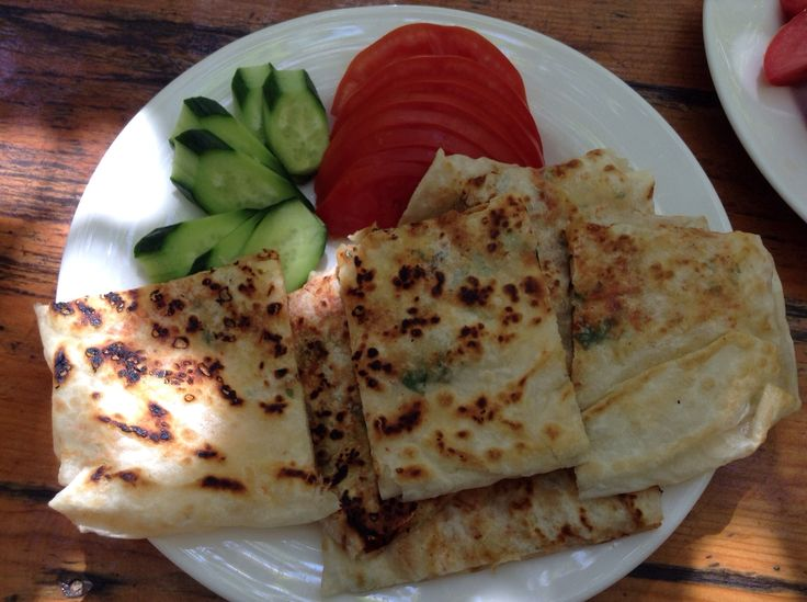 Gozleme fresh from the oven complimented with farm fresh cucumbers and tomatoes - the perfect lunch after a morning swim