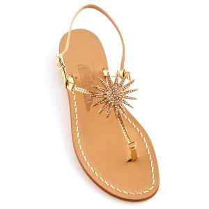 Eliana Canfora's sunniest style ever, these thong sandals gleam with gold rays of sunshine and a riot of rhinestones. Extra-thin straps allow the mystical sun medallion to magically float on your foot.