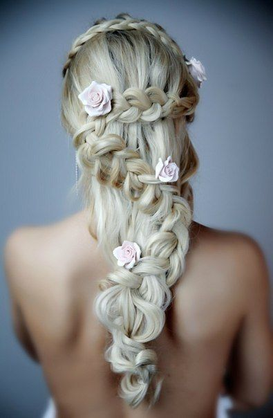 Very pretty braid decorated with flowers. Perfect wedding hair style.