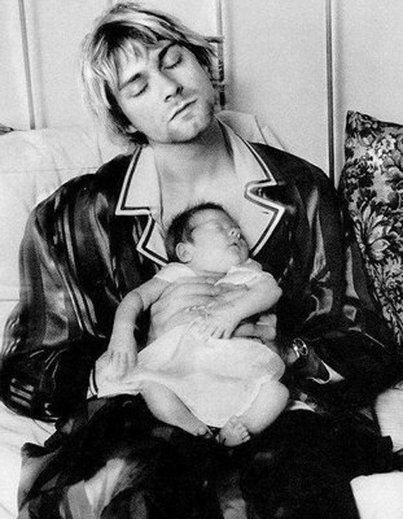 Kurt Cobain with his baby daughter (Frances Bean Cobain),  ca. 1992. °