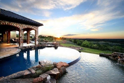 This tiered pool takes its cues from the agrarian structure of rice terraces and perfectly blends in with the lush landscape that surrounds it. It's the perfect place in which to watch the sky turn from blue to shades of orange and purple, ushering in the night.Swimming Pools, Custom Home, Lakes Home, Country Home, Texas Home, Outdoor Fireplaces, Texas Hills Country, Pools Design, Backyards Landscapes