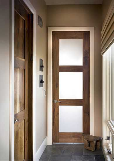 wooden doors with glass panels.....I think I am gonna build these for my house next weekend :)