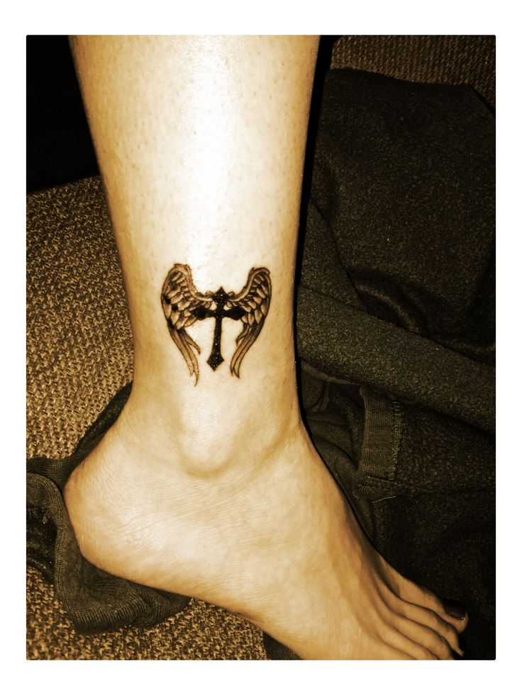 angel wings and cross tattoo. (would get on back between shoulder blades)