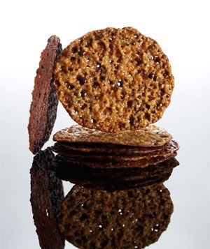 Florentines  Delicate, lacy cookies boast a layer of chocolate on one side for an extra-decadent treat.