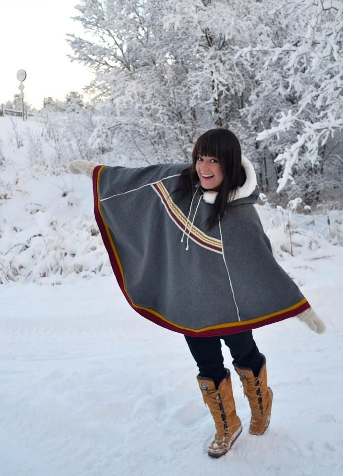 """""""My beautiful, nice neighbor in her new luhkká. This luhkka was fun sewing. Ragnhild knew exactly how it should be, both color and fur collar. (I should mention that it's fake fur.) -- Love this luhkka, the colors used, the fur collar, the length. WANT."""