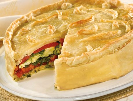 Torta Rustica - Served at room temperature, this delectable torta makes a beautiful presentation for a holiday or special meal. It looks complicated, but takes only 30 minutes to assemble, and you can make it ahead! Your guests will be delighted with the fabulous combination of cheese, egg, meat and vegetables all encased in flaky puff pastry.