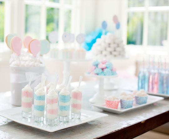 Baby Shower. Pink-and-blue themed gender reveal party. A reveal party is a great way for parents to share in the discovery of their baby's gender. Themed decor, fun guessing games and a sweet reveal activity make it the perfect way to share a special moment with friends and family.