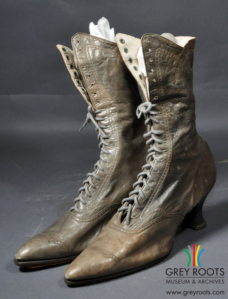 A pair of ladies', high-topped, green-grey, Finkelstein Bros. boots. The boots have extremely pointy toes and Queen-style heels. Grey Roots Museum & Archives Collection.