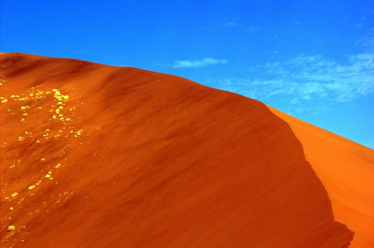 Intensely red and orange dunes of the Namib-Naukluft National Park of #Namibia.  These dunes contain high amounts of Iron which has oxidized over thousands of years to produce the intense colours. #Africa