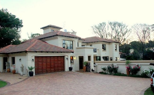 The epitome of executive country living this stunning double storey home offers everything you need for high class living. There are two reception rooms and the open plan dining room leads to a large undercover enclosed patio with braai area with concertina doors leading to a sparkling pool.   To view more beautiful properties like this one, visit the 9 PROVINCE property portal for South Africa at https://nineprovince.co.za/
