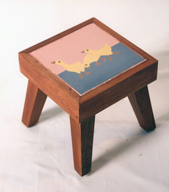Small Stool with Tile. The material is made from solid mahoni wood with natural finishing and mix tile on the top. The size is 24,5cm x 24,5cm x height 24 cm