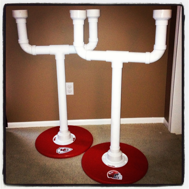 """Cornhole Beer Holders- Can be made for $25-$35 each.  Everything you need is at your local Home Depot! Field Goal is made with PVC pipe and the base is wood (already cut into a circle for $6) Connected with a flange. (Plastic is cheaper than those made with metal). The body of the field goal is 2"""" tall. We added our own sticker decals.....Go Chiefs!"""