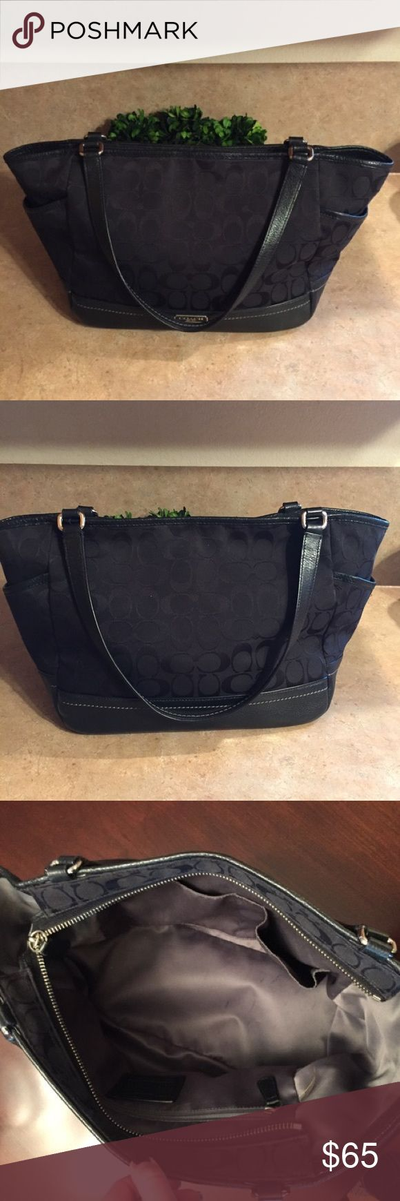 Black Coach Purse Authentic black coach purse. Used generously, but still in good condition! Zipper enclosure. No rips or tears on inside of purse, straps, or on bottom of the purse. Pen marks can be seen in the bottom of the purse from normal use. It has an inside zipper & two small inner pockets. There are also two pockets on the outside sides of the purse. Inside one these pockets, there is red ink, which can be seen in the last photo.  The red ink cannot be seen unless you open up the…