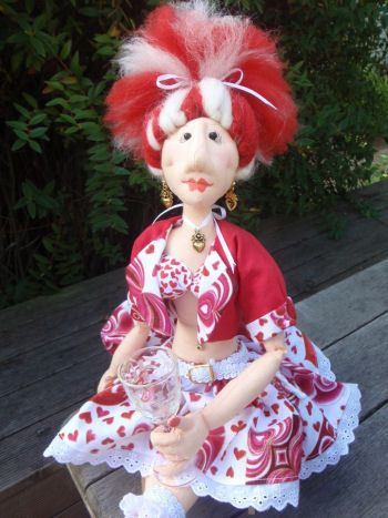 Cherry Cherry is a 20 inch tarty barmaid and is ready for St. Valintine's Day. She is gorgeous with her heart covered ensemble and her needle-sculpted face. Pattern includes step by step instructions and diagrams.  Cloth Doll Making (Sewing) Patterns by  Raewyn Parker of  Red Hen Designs