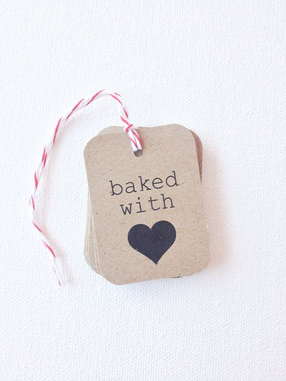 Kraft brown Baked with Love tags. Perfect for the holiday treats you will handout. Great for a Christmas gift or use at a bake sale.    { Details } Sold as a set of 12 tags  tags measure 1 1/2 x 2 Printed on kraft card stock  Ships with 12 feet of twine in a color of your choosing  Please specify in the notes to seller box, your twine color choice. If no selection is noted, then natural will ship.    Need a different qty? No problem! You can purchase multiple quantities of this listing at…