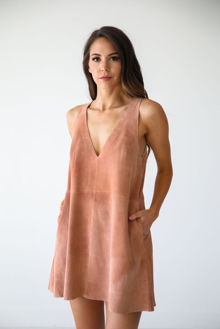 "• Sleeveless v-neck mini pink suede dress with pockets • Available in sizes XS, S, M, L. Model is 5' 7"" and wearing a size XS • 100% Suede"