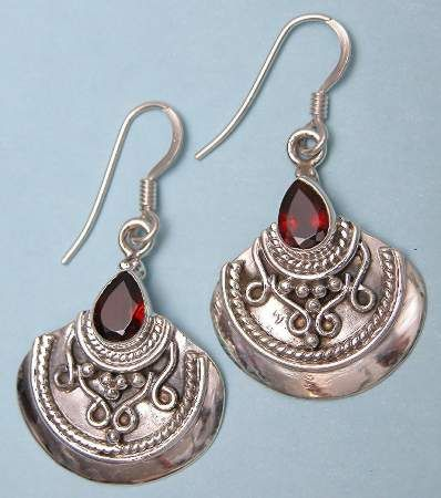 "Scimitar earring. Ethnic Indian style earring, main body measures .75"" wide by .75"" high. Available in Amethyst or Garnet."