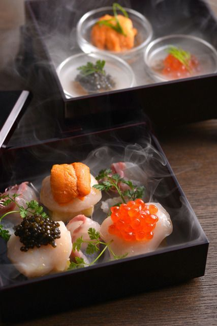 Delcious looking Sashimi with uni and roes with ice.