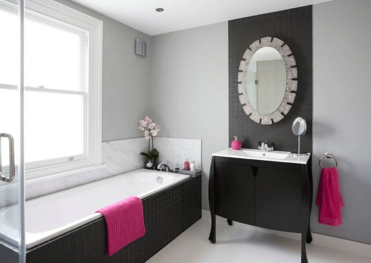 Pink-Accented Transitional Bathroom Towels are an easy and affordable way to add color to a neutral bathroom