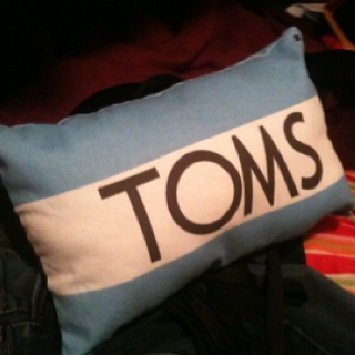TOMS flag idea, my latest pair came with a bag that would be even easier to turn into a pillow
