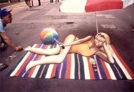 Girl on a beach towel 3D sidewalk art