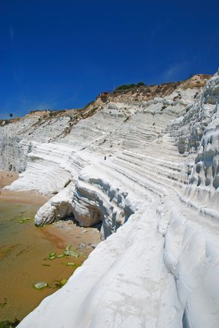 Scala dei Turchi, Sicily   Just 15 minutes from the Valley of the Temples in Agrigento, the brilliant white and weather-formed Scala dei Turchi juts into the sea off Sicily's southern coast.