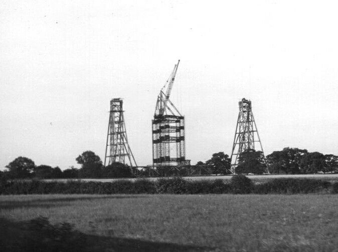 Early stages of Jodrell Bank radio telescope construction with just the beginnings of its two support towers visible