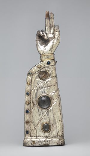 Arm Reliquary, 13th century, with 15th–century additionsFrenchSilver, silver–gilt, glass and rock–crystal cabochons over wood core MET