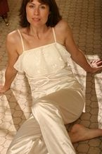 Ivory Satin Pyjamas - These pyjamas are made from Italian stretch satin. The top is specially designed so you can step in to the garment instead of raising it over your head as you may have limited arm movement. The embroidered frill at the front gives the top a beautiful feminine touch and the elastic waisted trousers are also very comfortable.