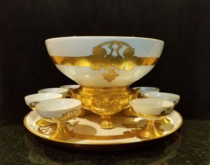 Painted Porcelain Punch Bowl Set 11-Pieces Signed c1917. Beautiful Opalescence to the porcelain. Bowl is signed: Katy Amonett -1917- (Pickard?).