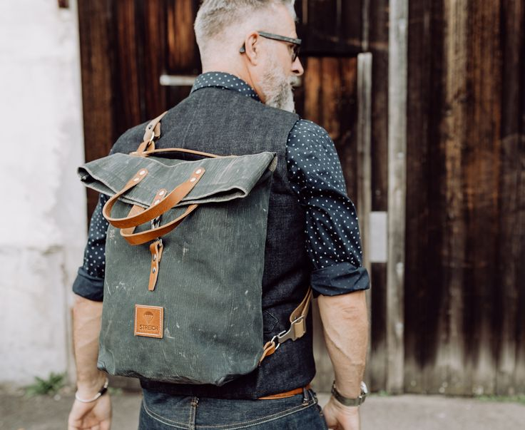 the SANTORINI bag by STREICH. it is made out of wwll swiss army tent canvas and czech army leather straps. #streichbag #brunostreich #backpack #bag #canvasbag #waistcoat #beard #whitebeard #beardmodel
