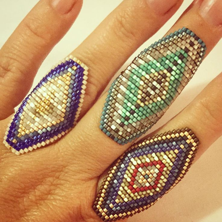 """Some busy fingers this week."" Brick or peyote stitch rings. #beaded #beads #delica"