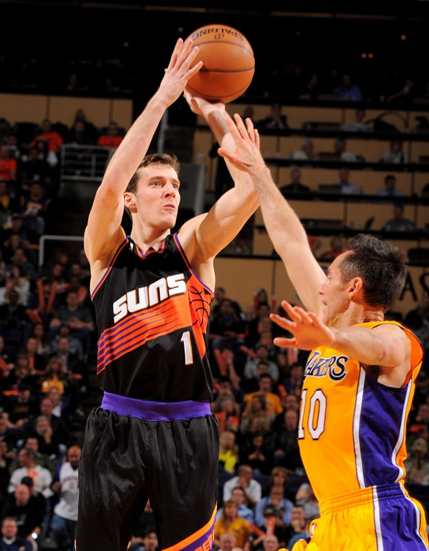 bf344d700fce Goran Dragic and the Phoenix Suns debuted their black retro jerseys during  a win over the Lakers on Jan. 30
