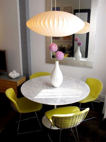 Love the chairs with the table! And how the shape of the chandelier is repeated in the vase...
