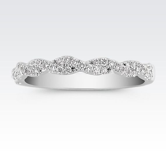 This unique Infinity design features 42 round pavé-set diamonds at approximately .25 carat total weight. These brilliant, hand-matched stones are set in a quality 14 karat white gold setting.