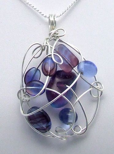 Wire pendant - I wonder if it was made free style or had a preconceived form in mind. Either way, a brilliant use of wire.