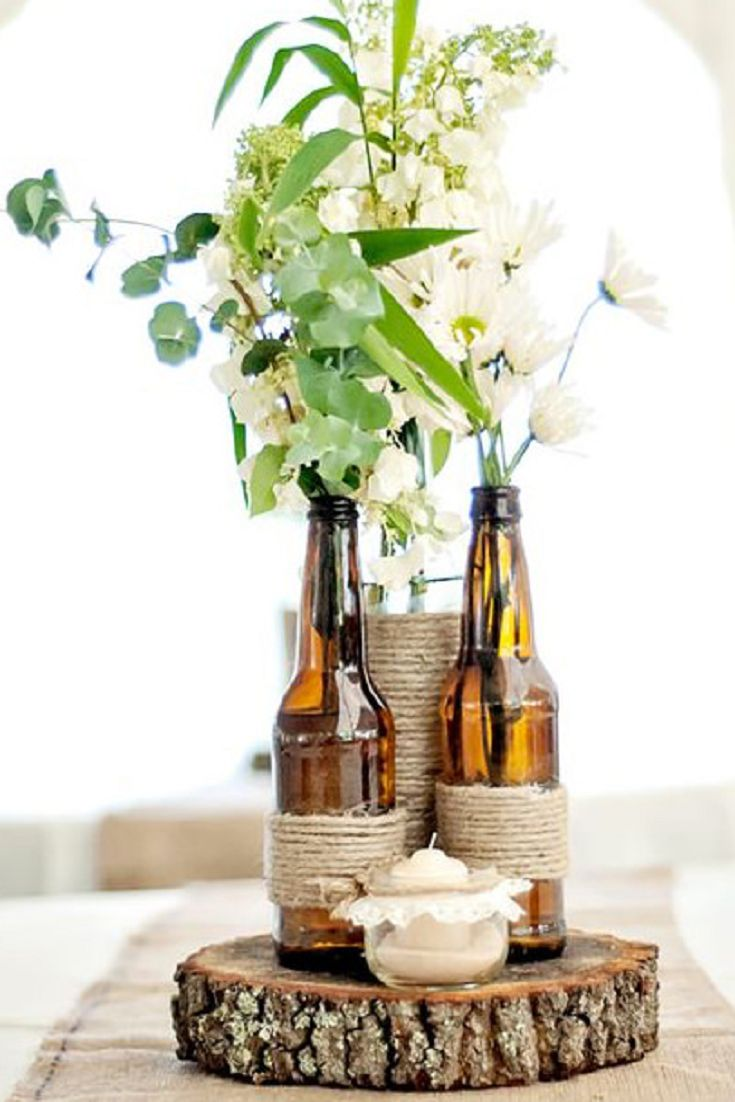 25 best wine bottle centerpieces ideas on pinterest for Wedding table decorations with wine bottles