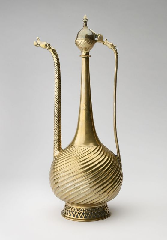Ewer with Dragon Heads, Deccan, first half of 17th century. Brass, with traces of gilding. H. 20⅛ in. (51 cm), W. 7⅞ in. (20 cm), D. 6¼ in. (16 cm). The Ashmolean Museum, Oxford. Presented by Miss Eleanor Butler, in memory of her father Dr. A. J. Butler, 1976. Image: © Ashmolean Museum, University of Oxford
